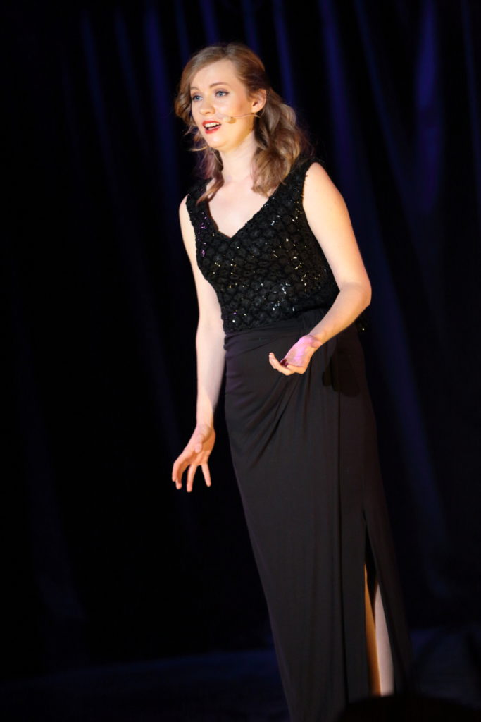 Performance singing Georgia Gray microphone